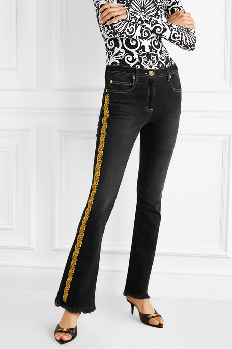 Frayed embroidered mid-rise flared jeans