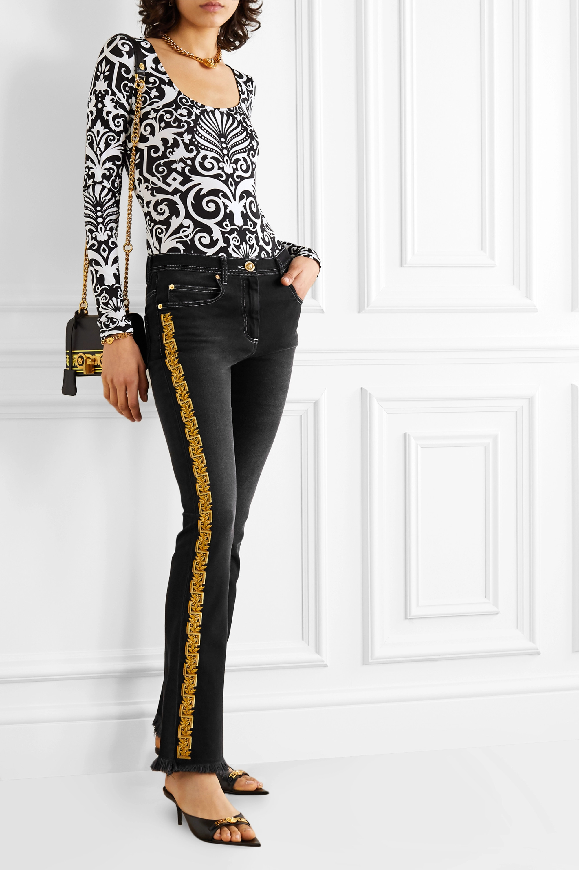 Versace Frayed embroidered mid-rise flared jeans