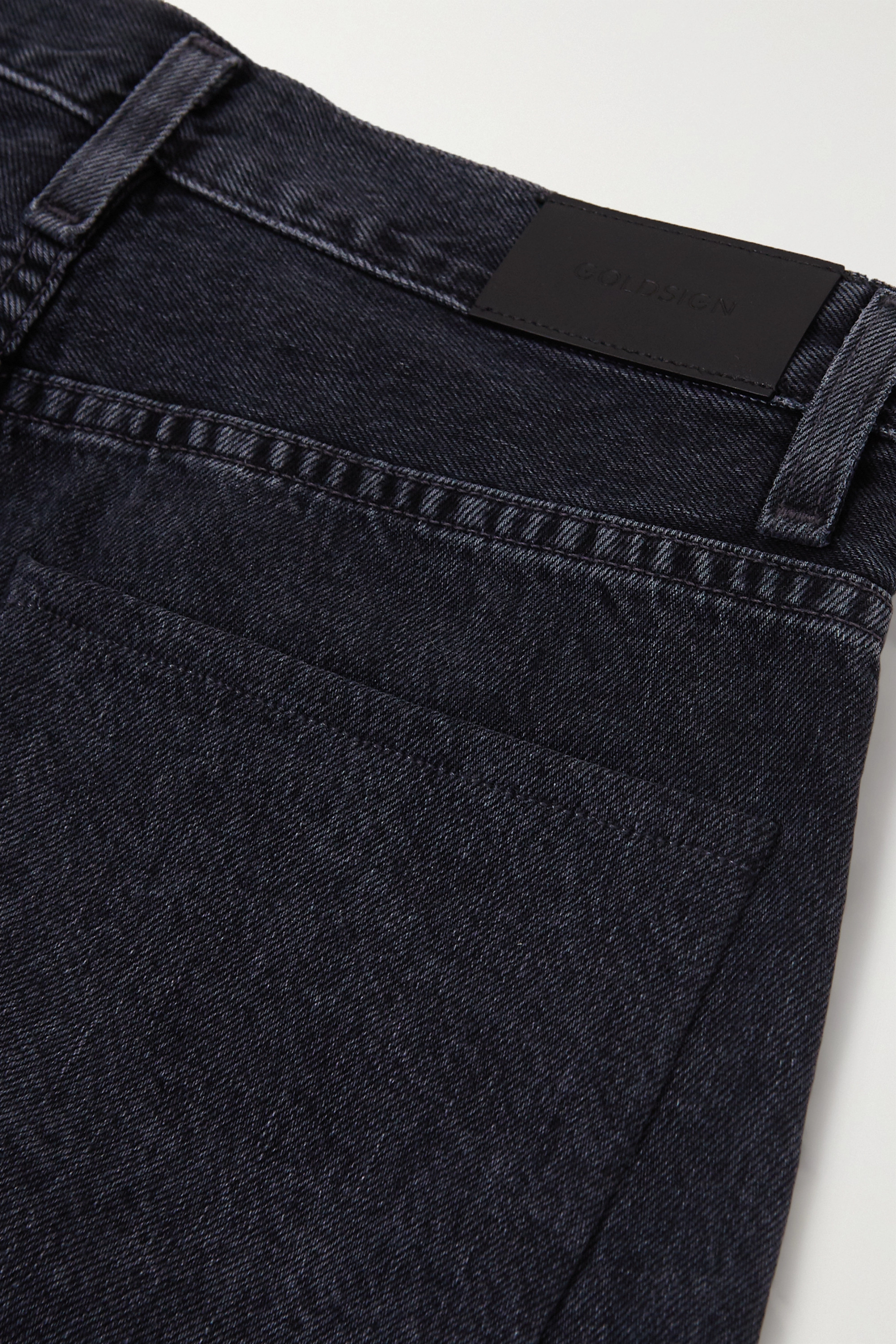 GOLDSIGN + NET SUSTAIN The Pleat Curve cropped high-rise tapered jeans