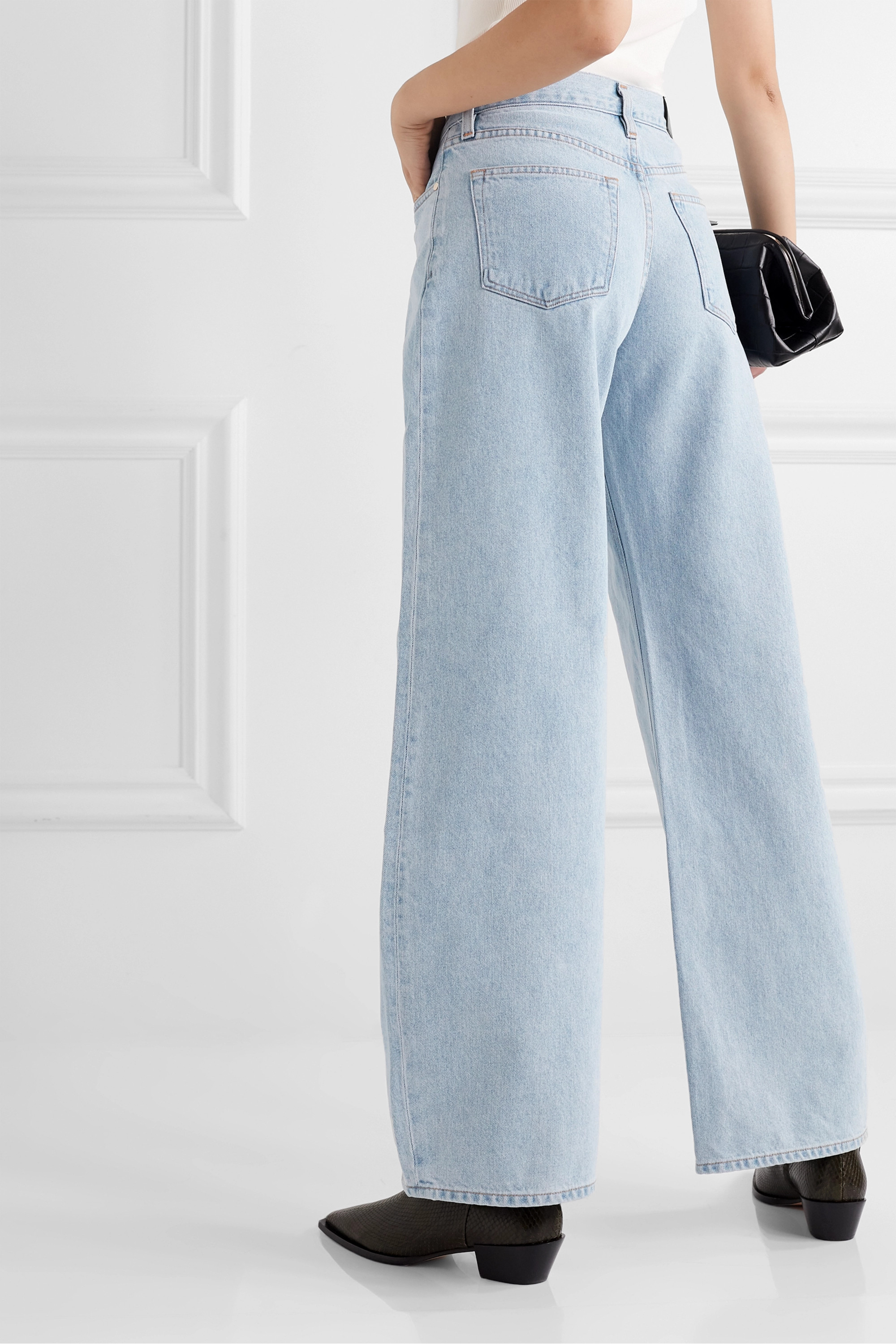 GOLDSIGN + NET SUSTAIN pleated high-rise wide-leg jeans