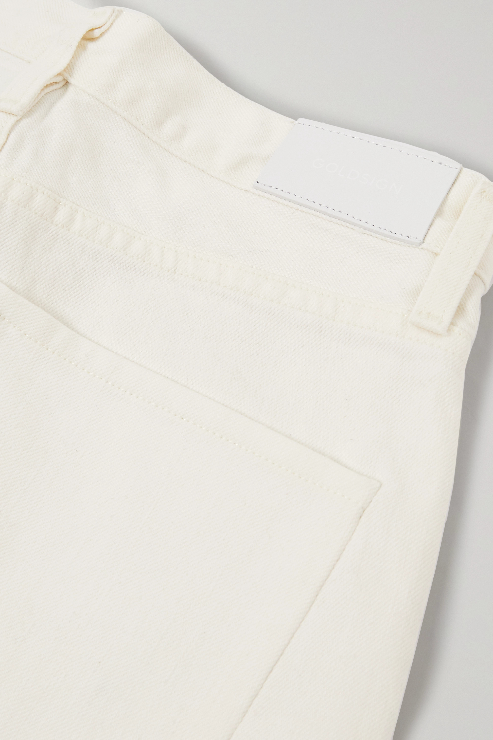 GOLDSIGN + NET SUSTAIN The Curved cropped high-rise tapered jeans