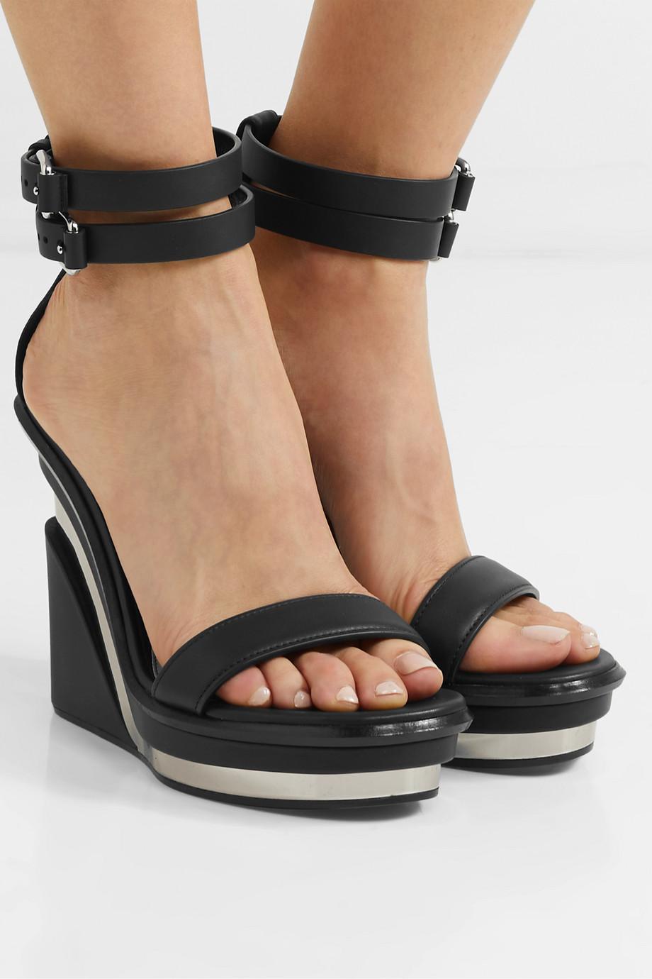 Alexander McQueen Buckled leather wedge sandals