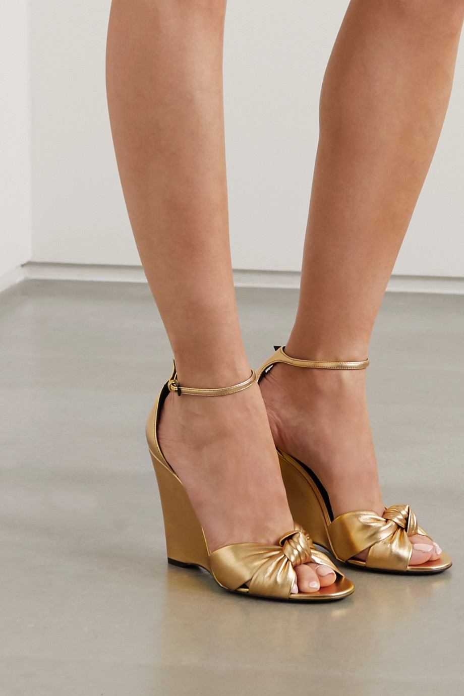 SAINT LAURENT Bianca knotted metallic leather wedge sandals