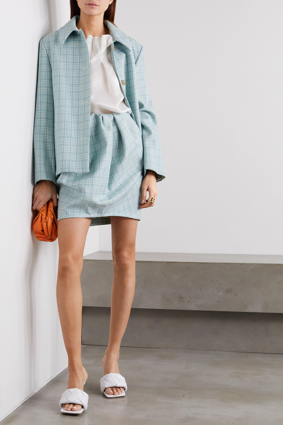 Nina Ricci Mini-jupe en tweed de laine à carreaux et à fronces