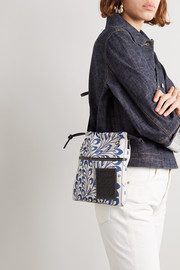 Leather-trimmed printed canvas pouch
