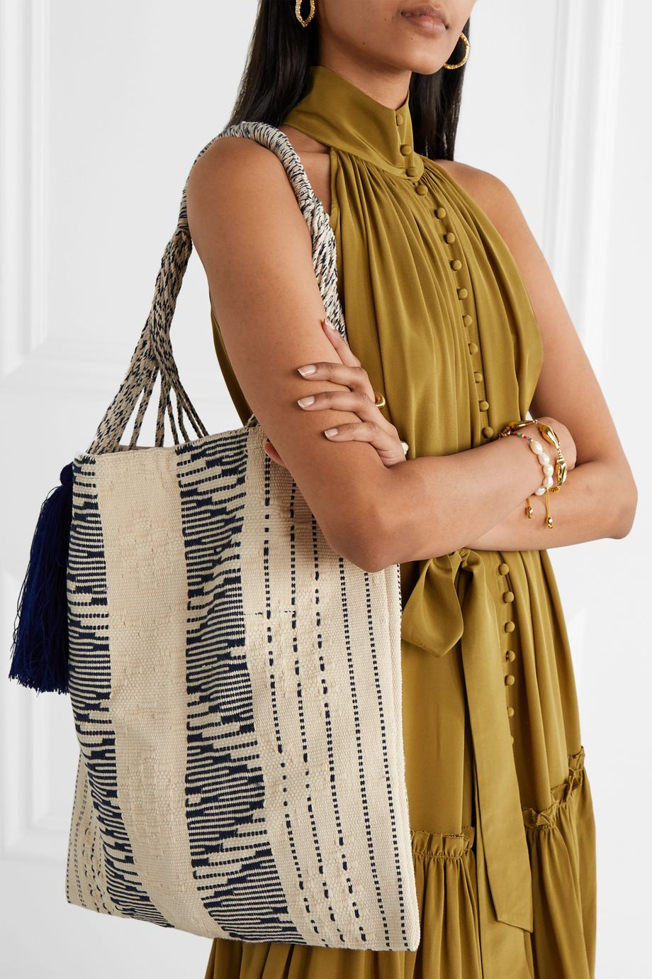 Nannacay + NET SUSTAIN Bianca tasseled crocheted cotton-blend tote