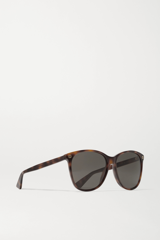 Gucci Sonnenbrille mit rundem Rahmen aus Azetat in Hornoptik