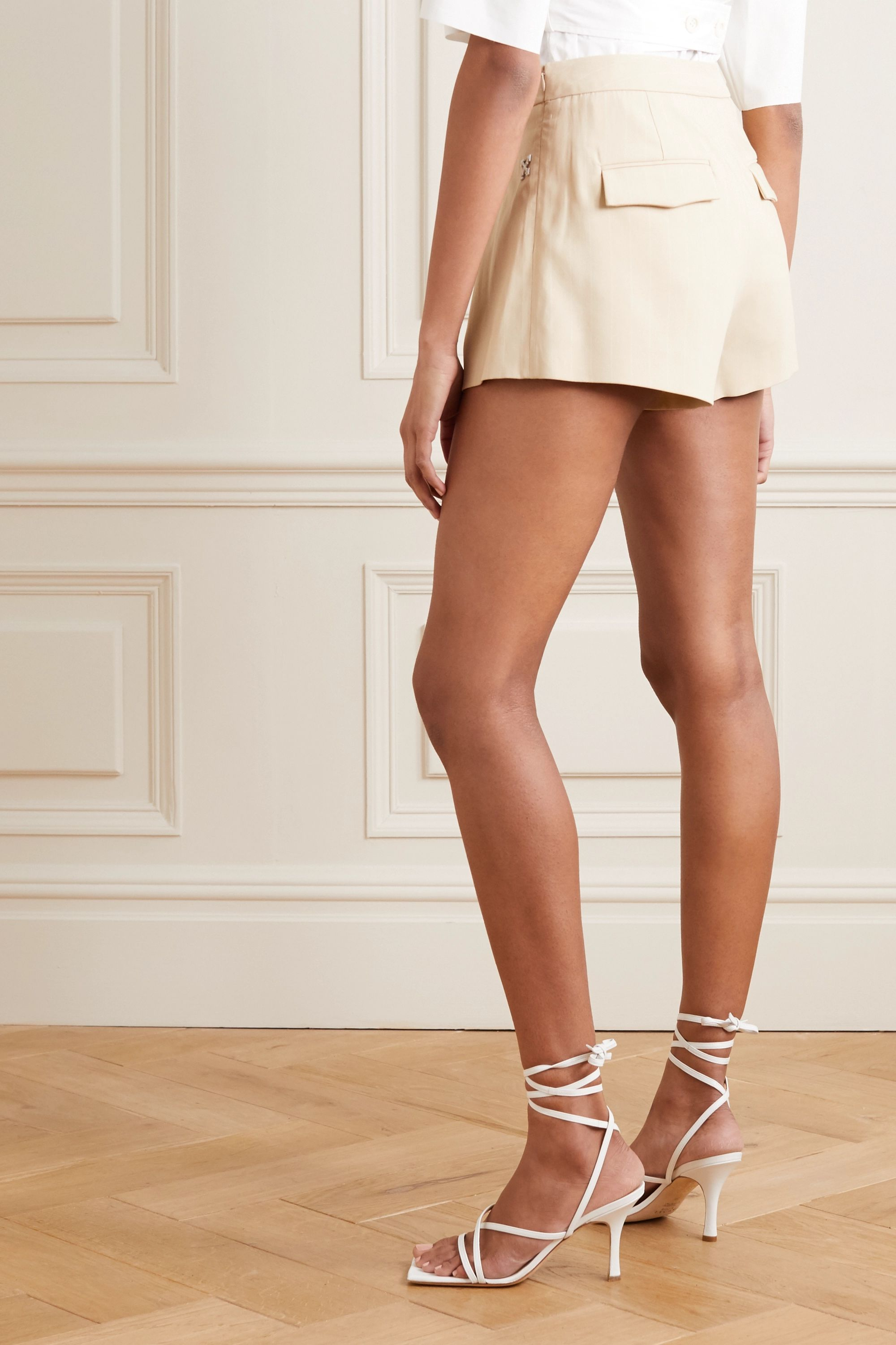 Off-White Embellished pleated pinstriped cotton-blend shorts