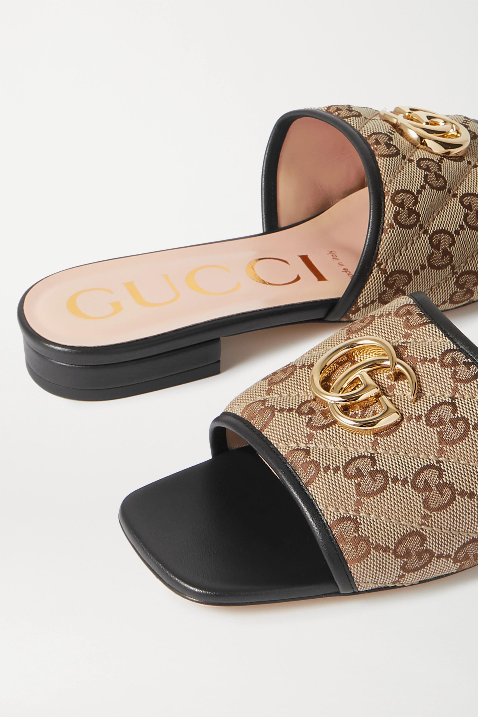 Gucci Jolie 皮革边饰带缀饰 Logo 细节帆布拖鞋
