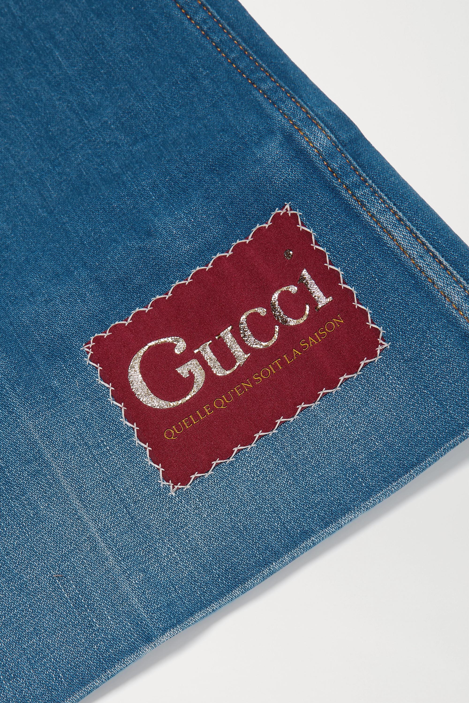 Gucci Hoch sitzende Schlagjeans mit Applikation