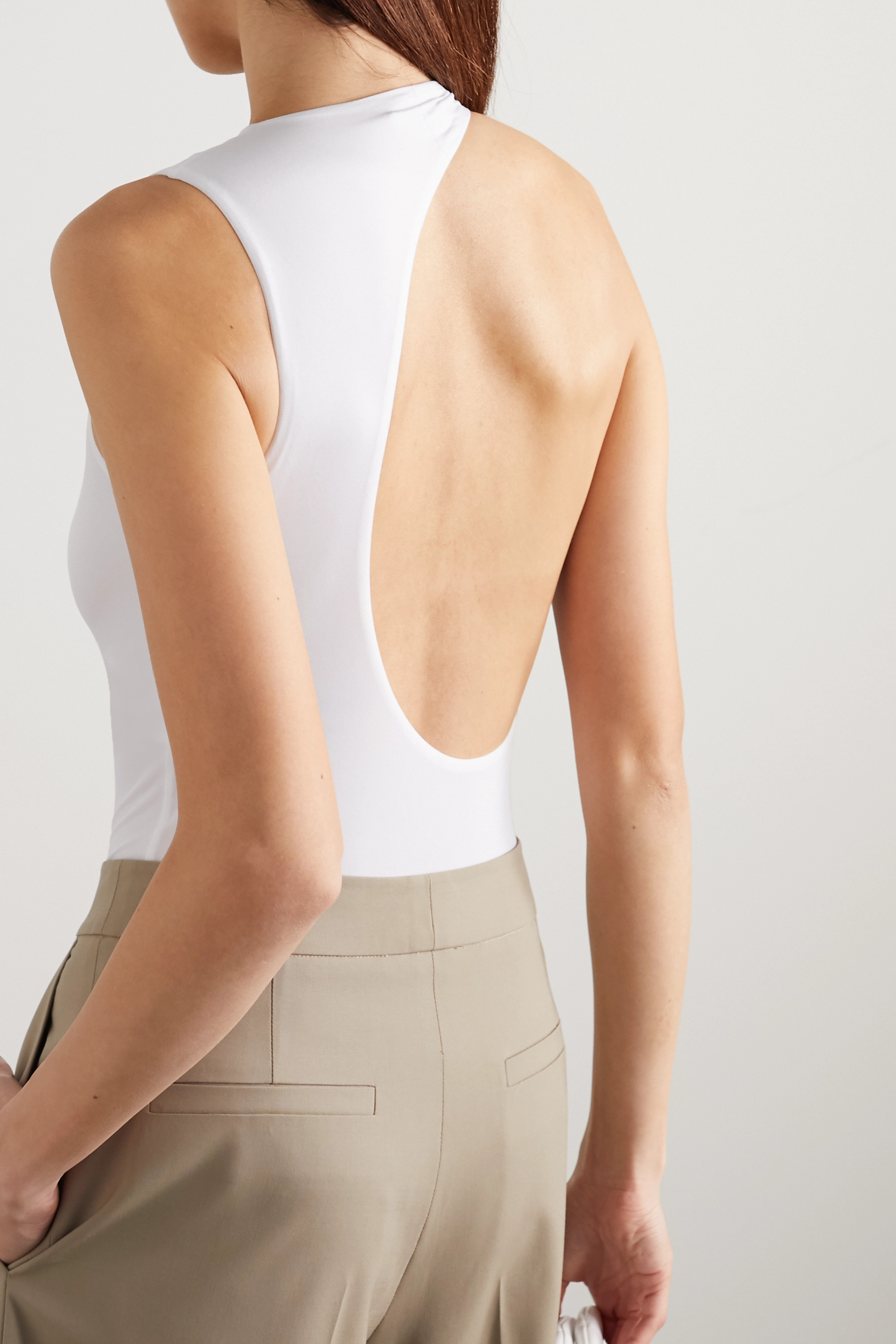 GAUCHERE Presly asymmetric open-back stretch-jersey bodysuit