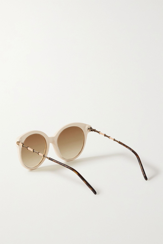 Gucci Lunettes de soleil rondes en acétate et en métal doré