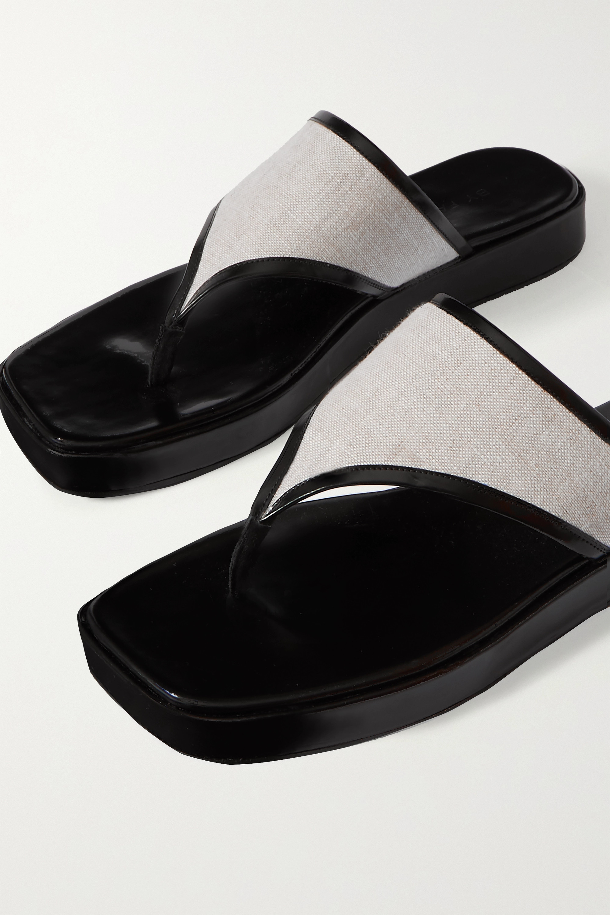 BY FAR Otto glossed-leather and linen flip flops
