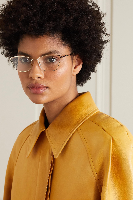 Miu Miu Eyewear Brille mit goldfarbenem Cat-Eye-Rahmen mit Azetat in Hornoptik