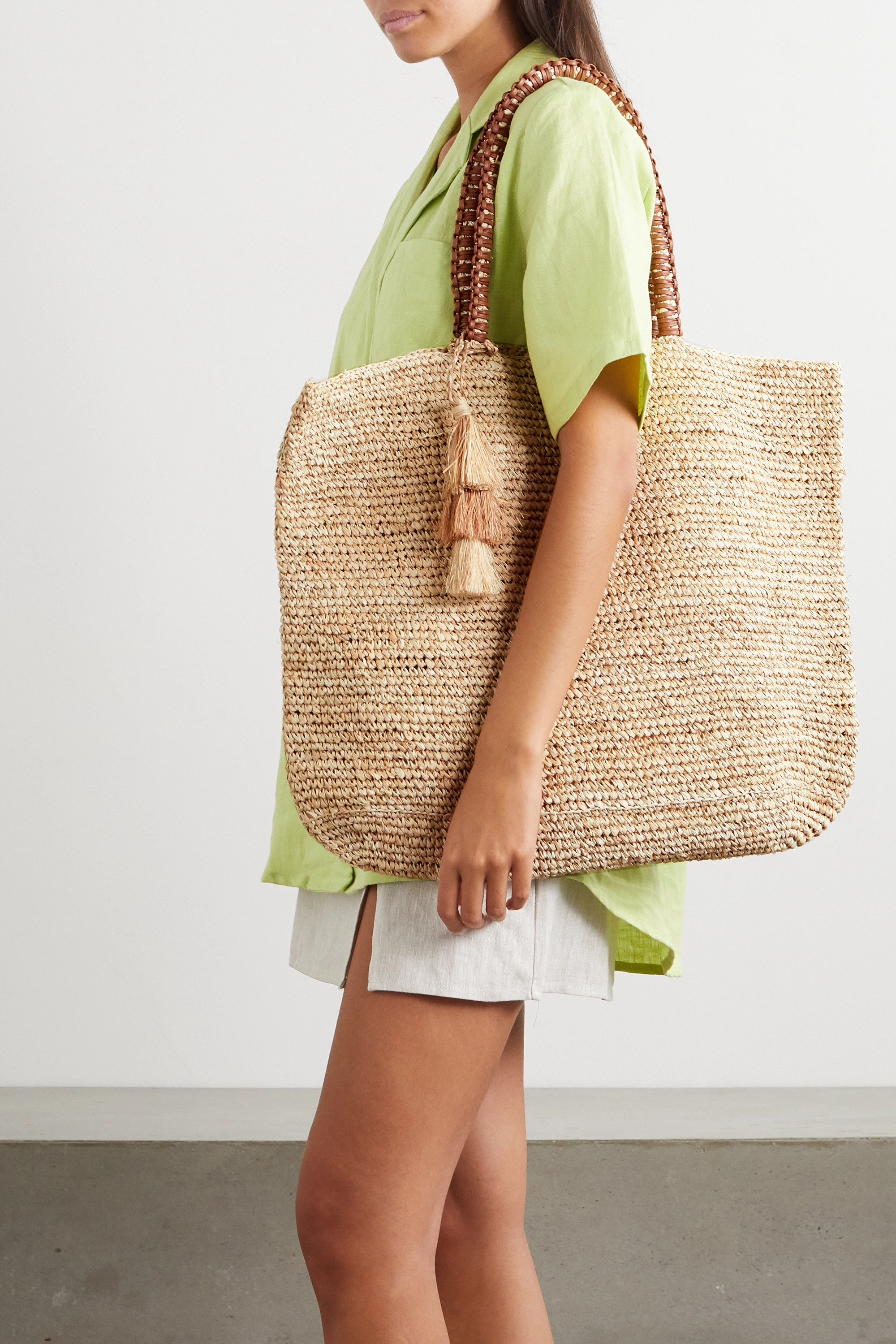 Kayu Haven tasseled leather-trimmed straw tote