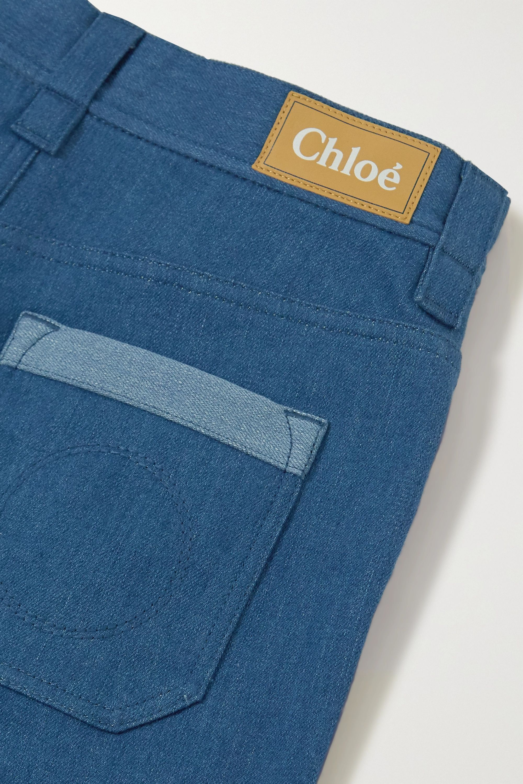 Chloé Cropped two-tone high-rise flared jeans