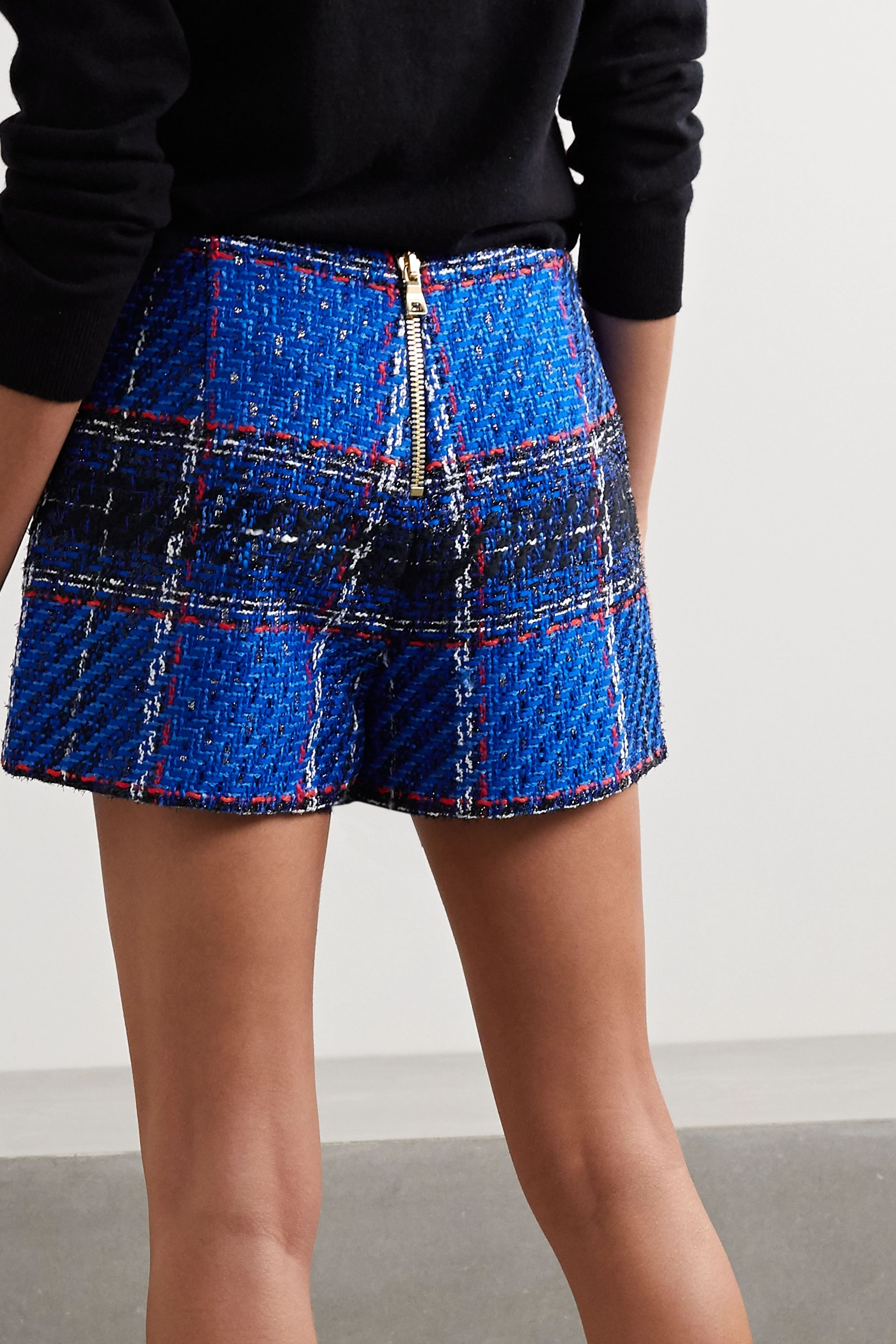 Balmain Asymmetrische Shorts aus kariertem Tweed mit Fransen
