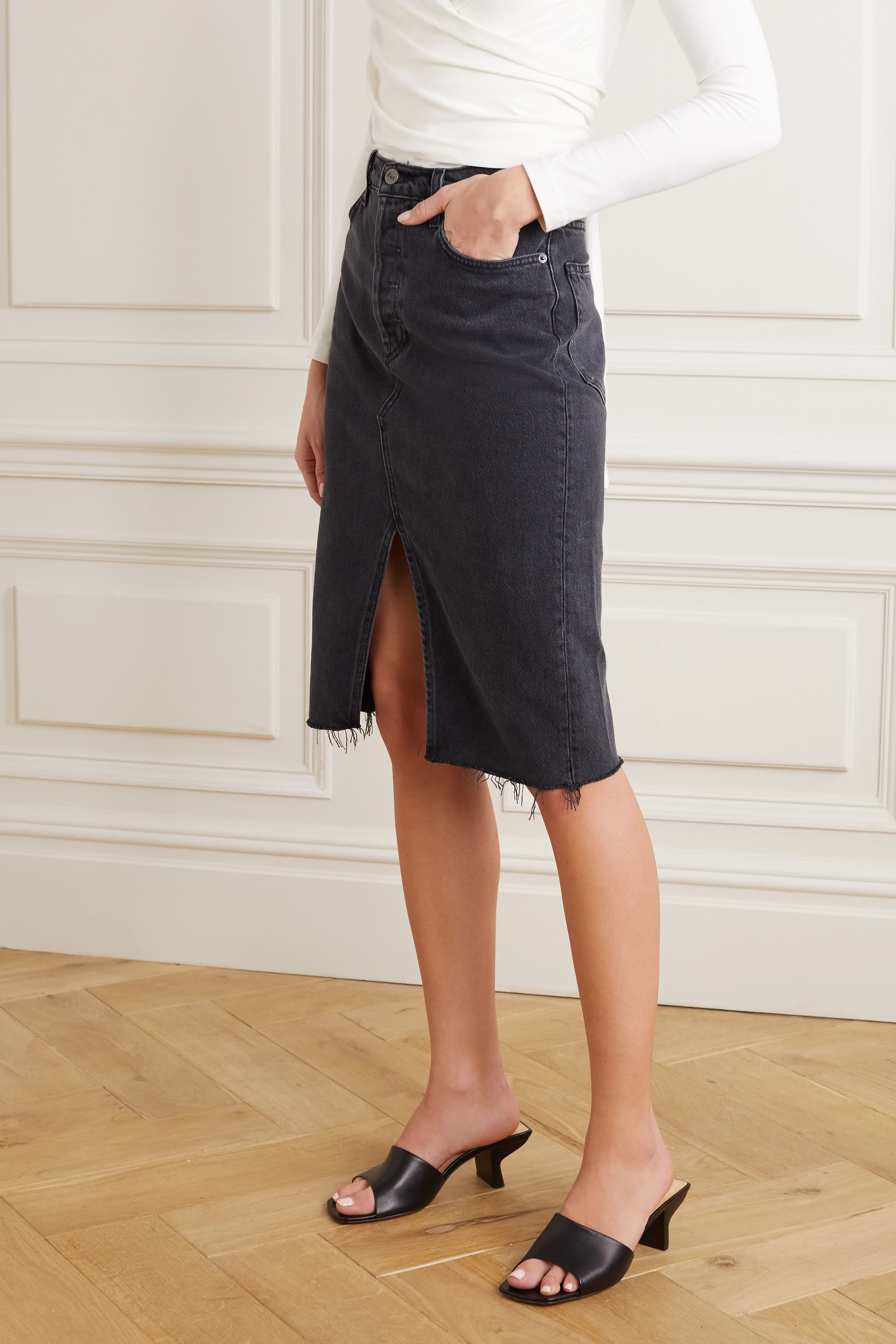 Reformation + NET SUSTAIN distressed denim skirt