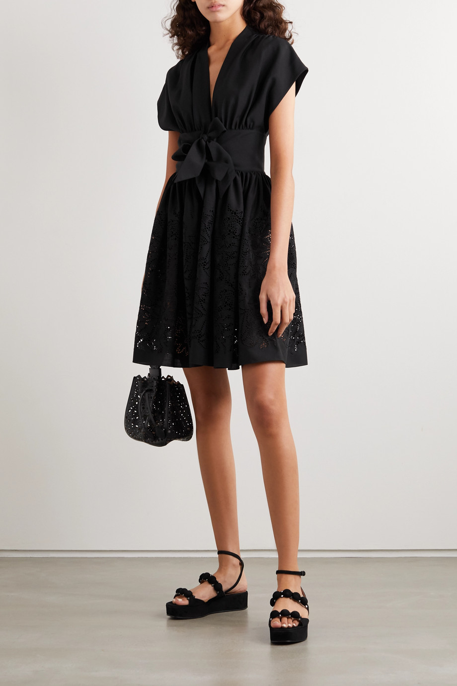 Alaïa Bow-embellished laser-cut wool mini dress