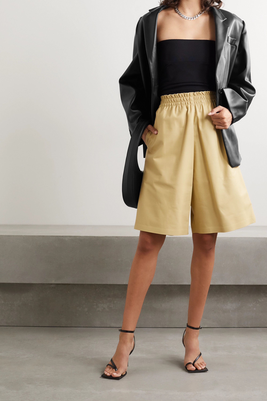 Pushbutton Paneled faux leather and denim blazer