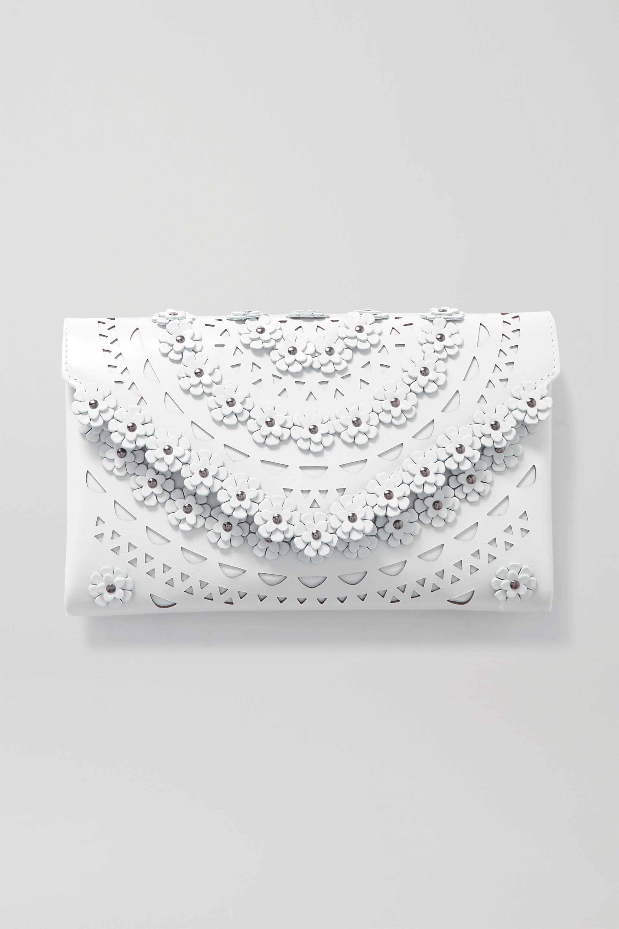 Alaïa Studded laser-cut leather clutch