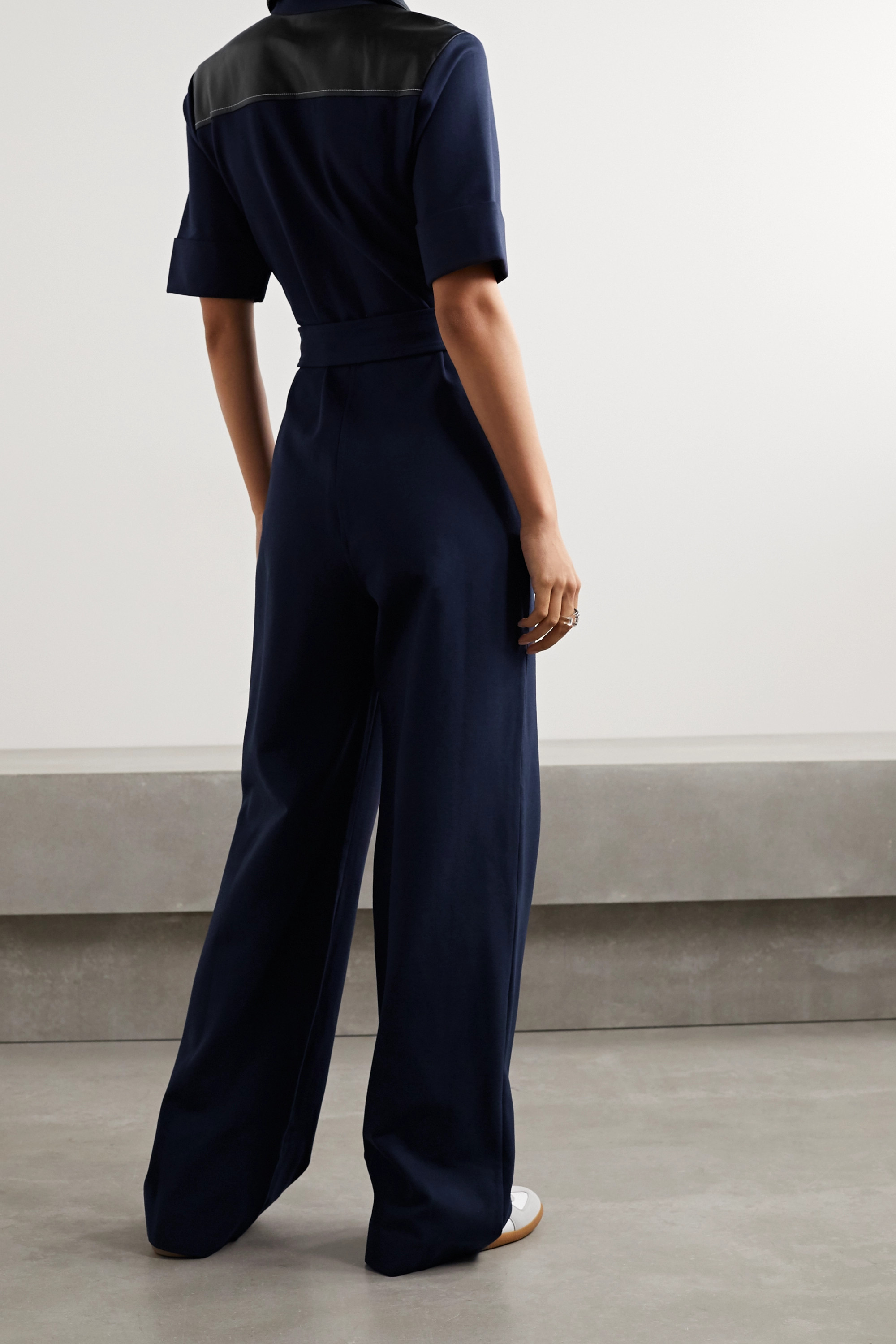 STAUD Davey belted faux leather-trimmed stretch-jersey jumpsuit
