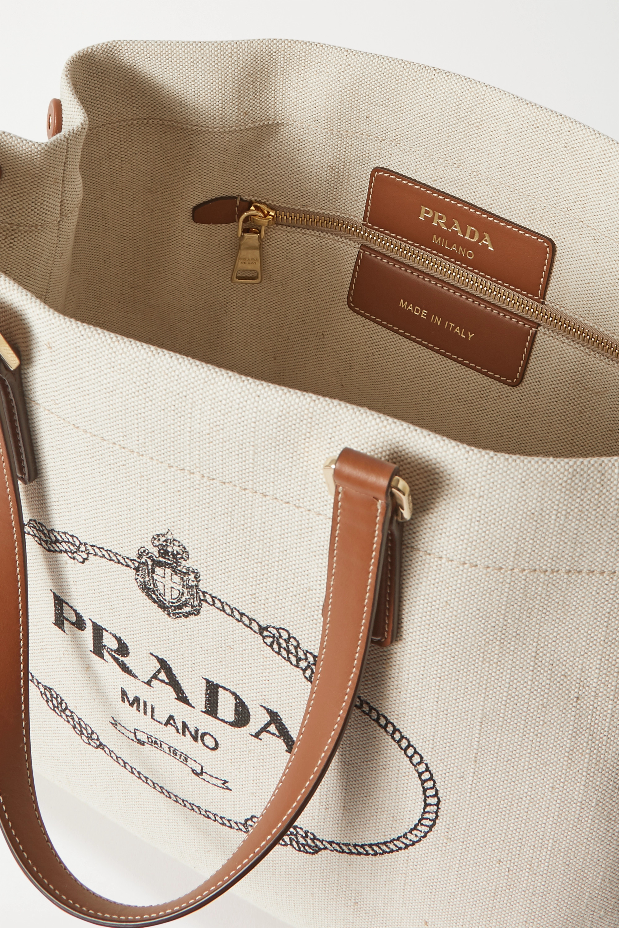 Prada Large printed leather-trimmed canvas tote