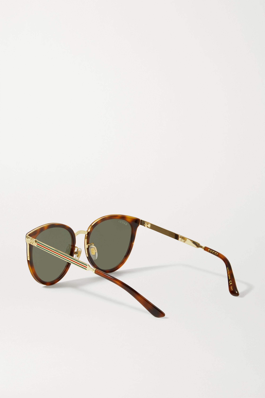 Gucci Cat-Eye-Sonnenbrille aus Azetat in Hornoptik mit goldfarbenen Details