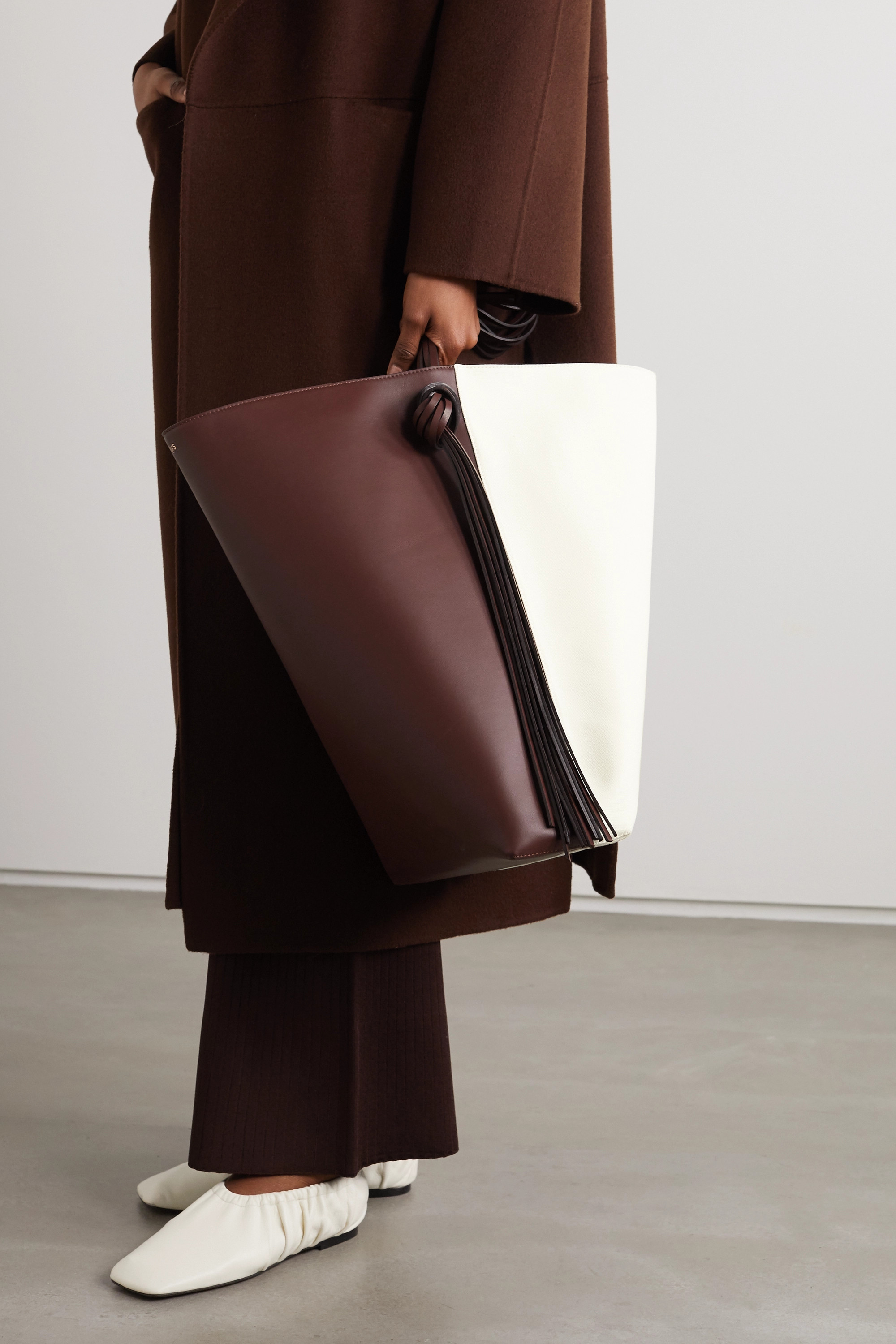 Neous Saturn oversized tasseled leather and canvas tote