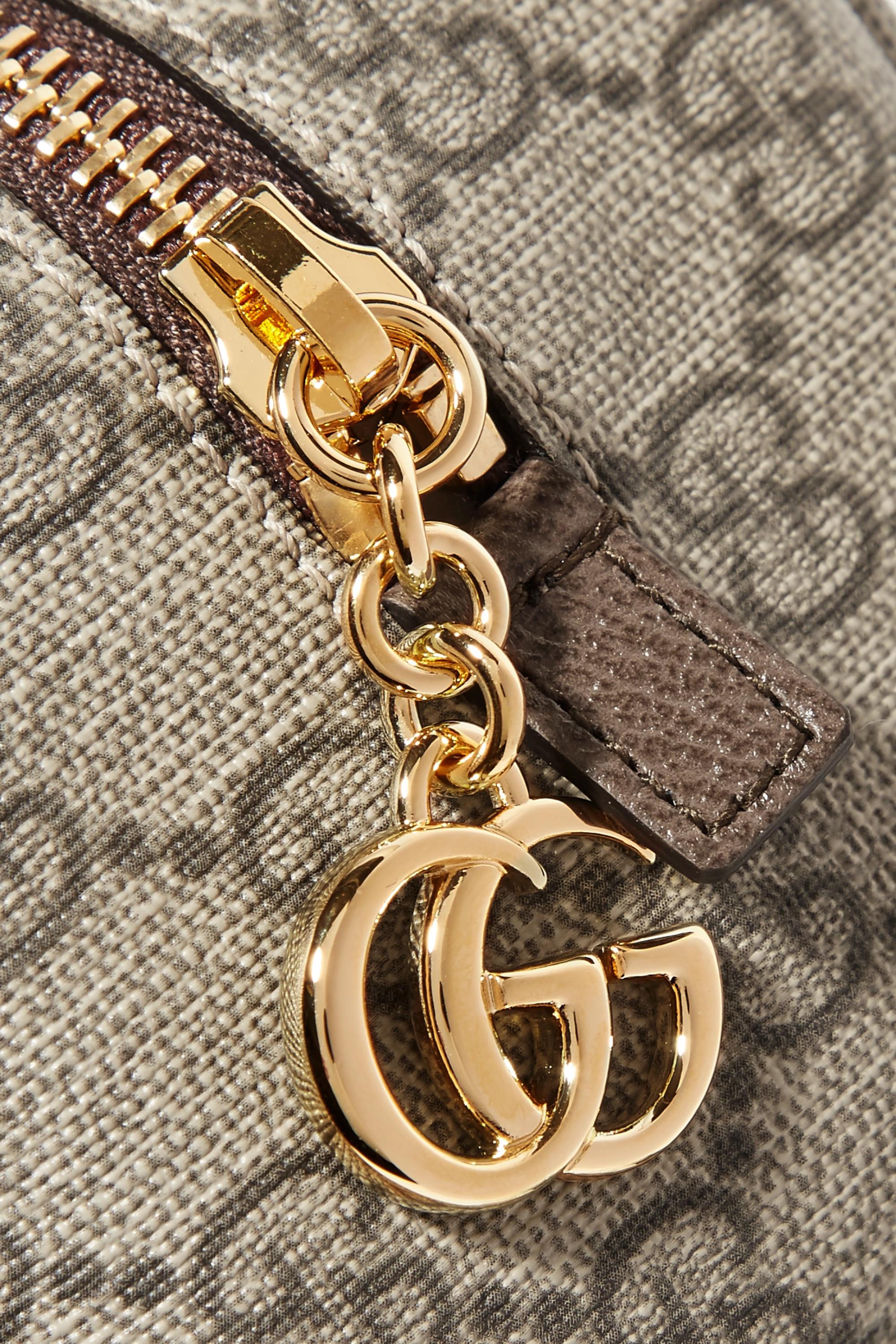 Gucci Trousse à maquillage en toile enduite imprimée et en cuir texturé Ophidia Medium