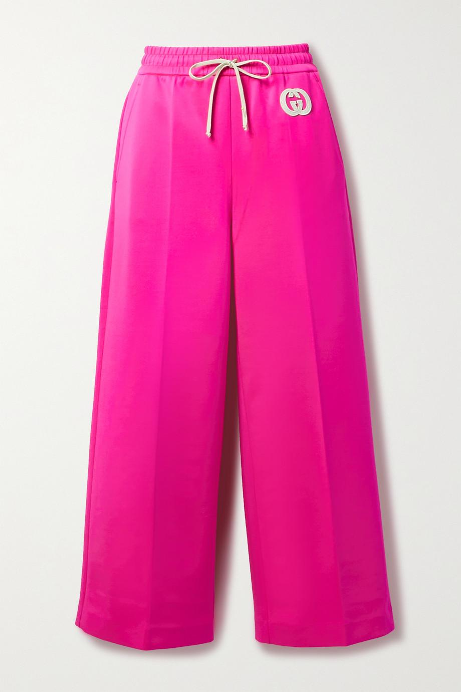 Gucci Verkürzte Jogginghose mit weitem Bein aus neonfarbenem Stretch-Jersey mit Applikation