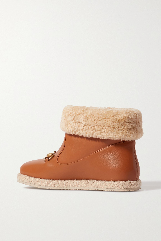 Gucci Bottines en cuir à finitions en peau lainée synthétique et à mors de cheval Fria