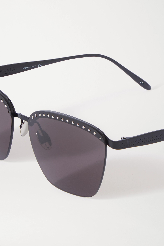 Alaïa Sonnenbrille mit eckigem Rahmen aus Metall mit Nieten