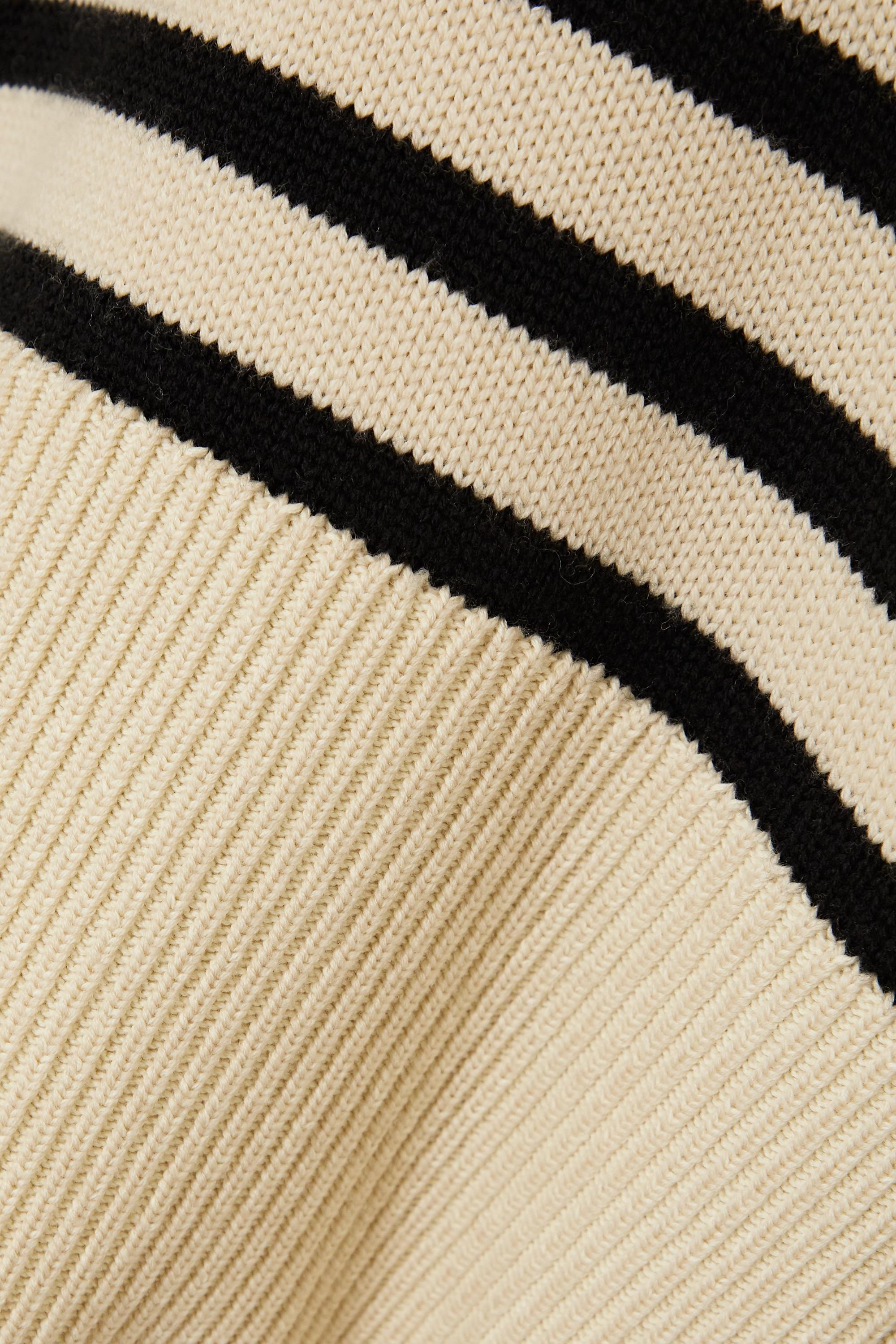 Totême Pull à col roulé en laine mérinos à rayures