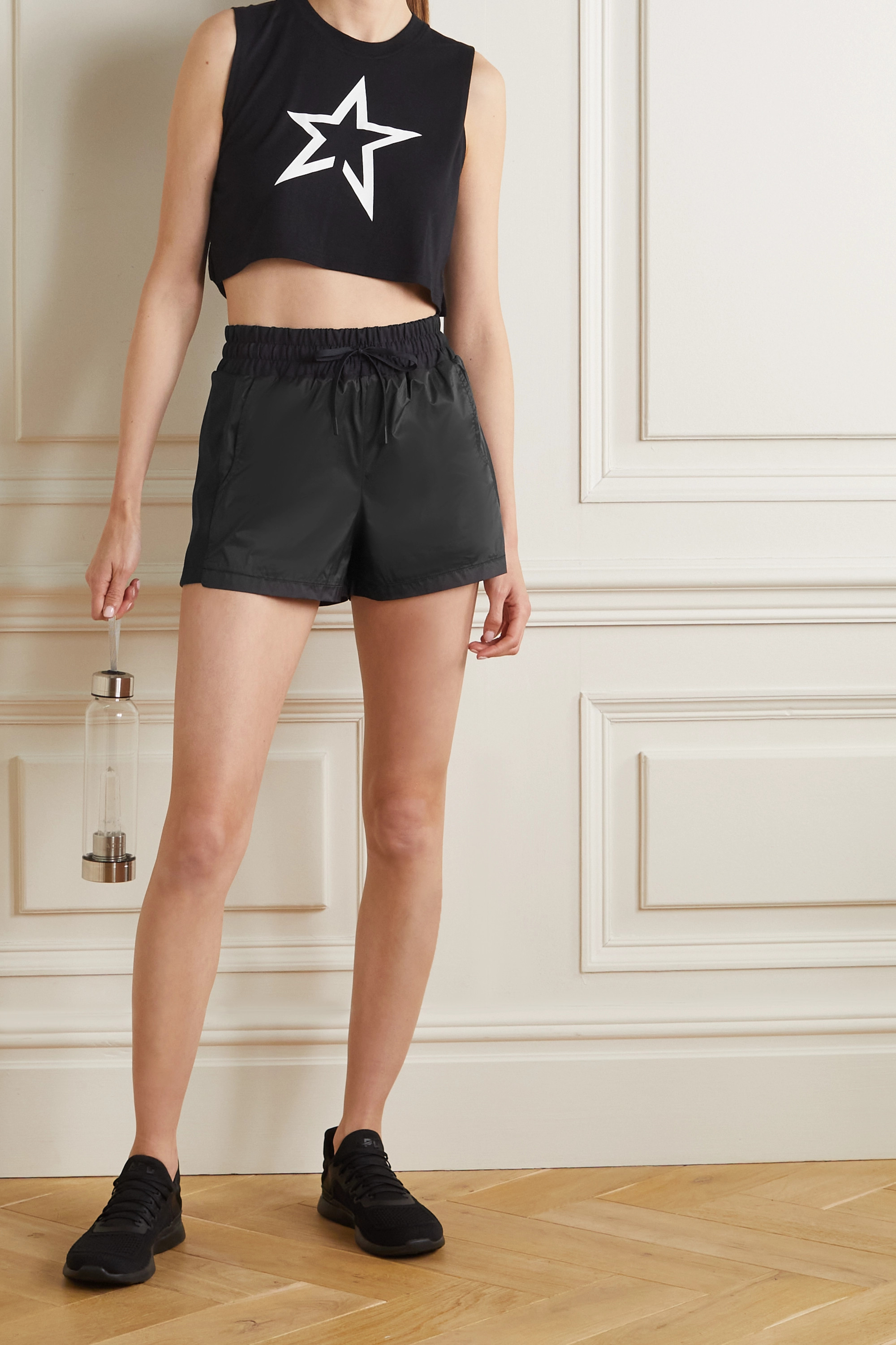 Perfect Moment Jersey-trimmed shell shorts
