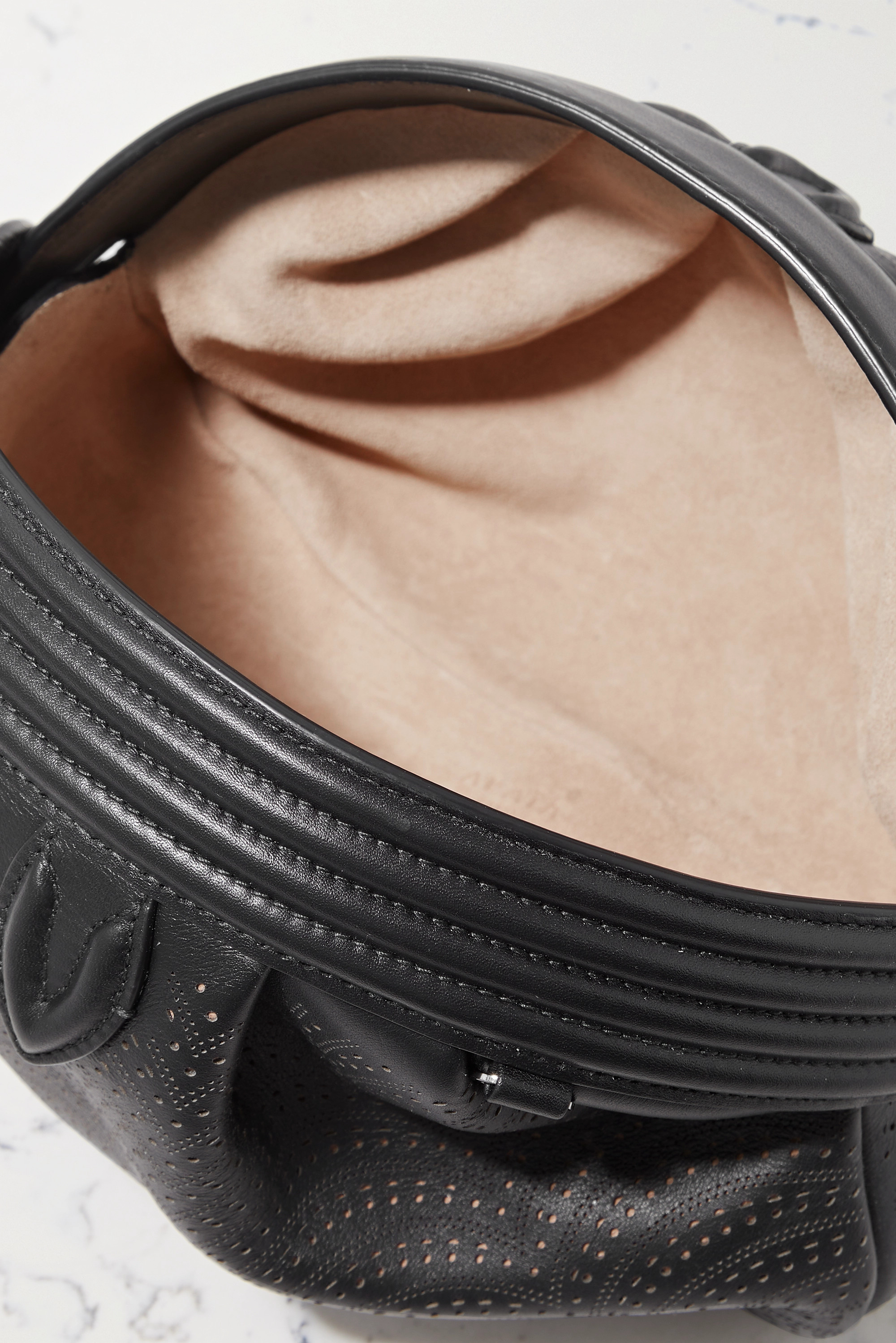 Alaïa Sami 21 small laser-cut leather clutch