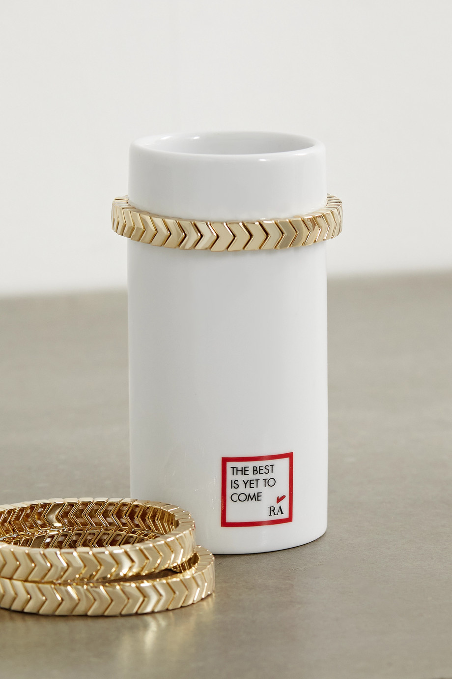Roxanne Assoulin Stack 'Em Up porcelain vase and set of three gold-tone bracelets