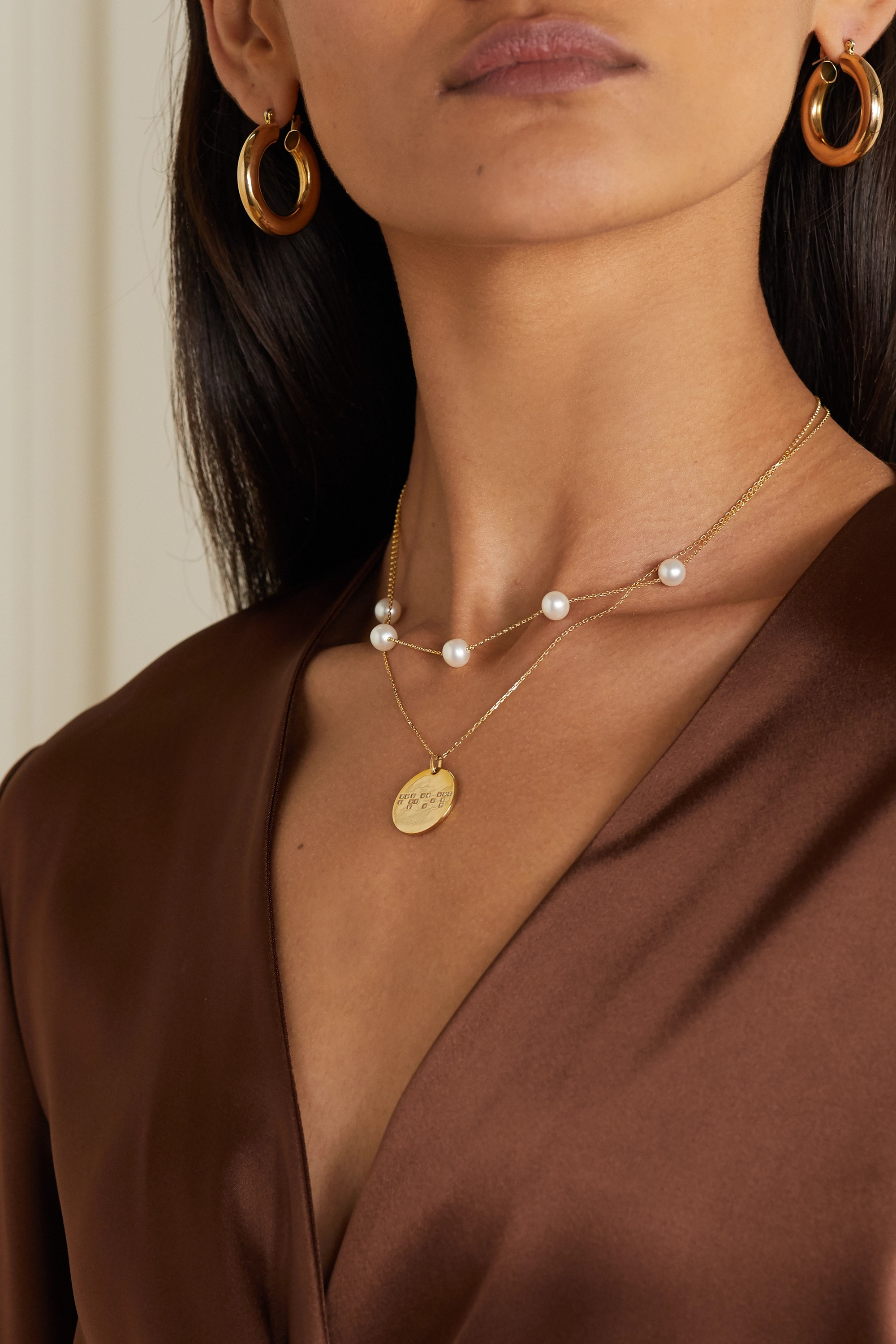 Anissa Kermiche Frost in May 14-karat gold pearl necklace
