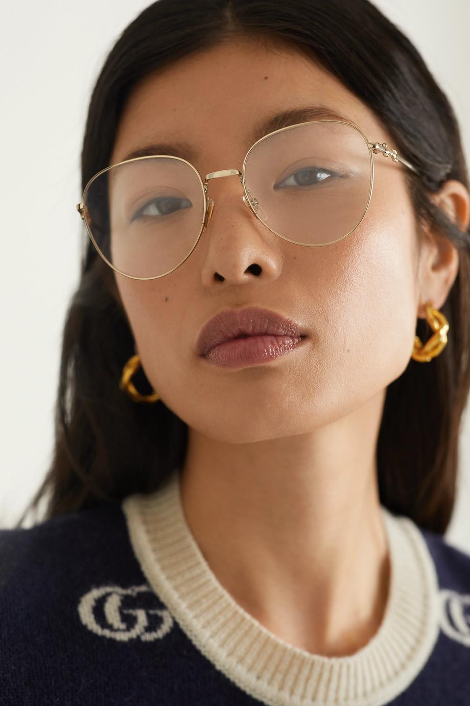 Gucci Lunettes de vue rondes dorées
