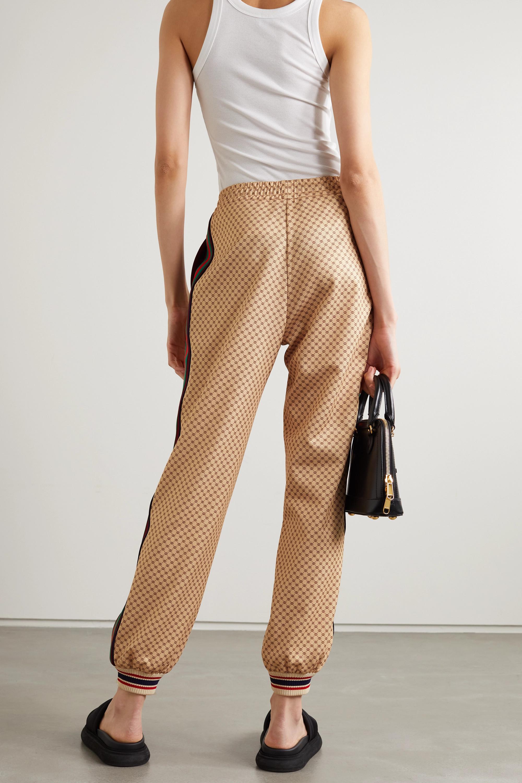 Gucci Pantalon de survêtement en jersey technique imprimé à rayures et à appliqué