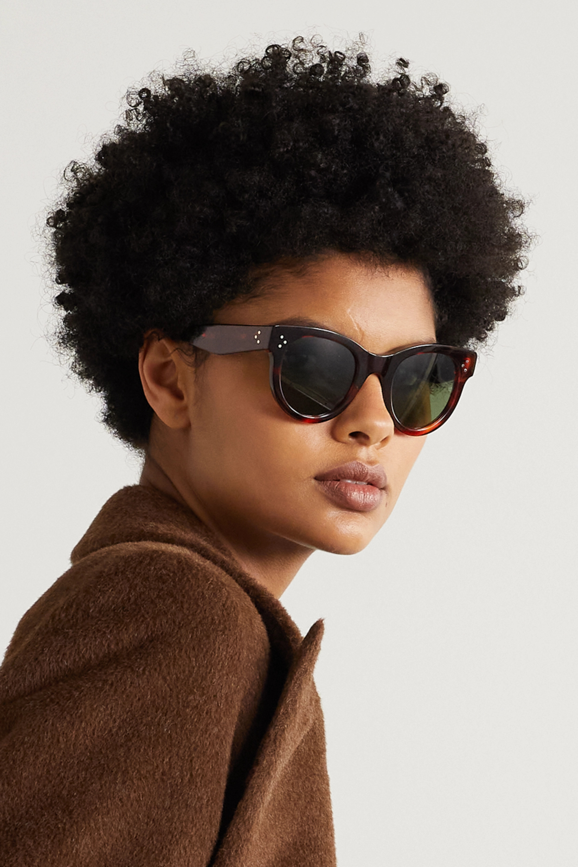 CELINE Eyewear Lunettes de soleil rondes en acétate effet écaille