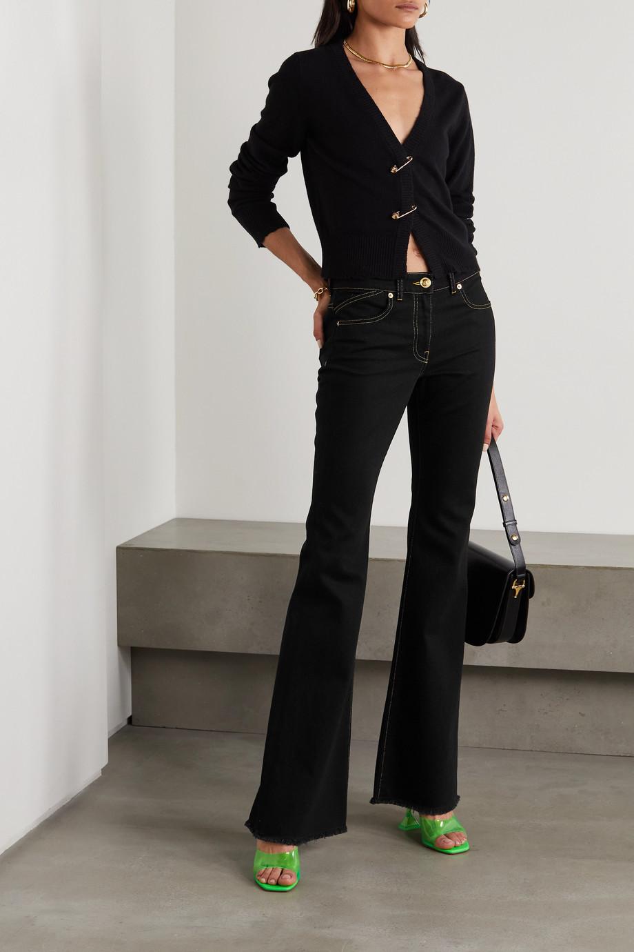 Versace Hoch sitzende Schlagjeans mit Fransen und Stickerei