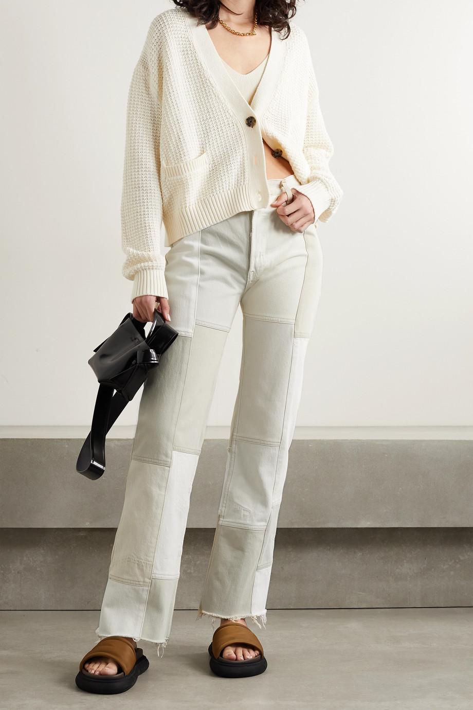 RE/DONE 70s hoch sitzende Jeans mit geradem Bein und Fransen in Patchwork-Optik