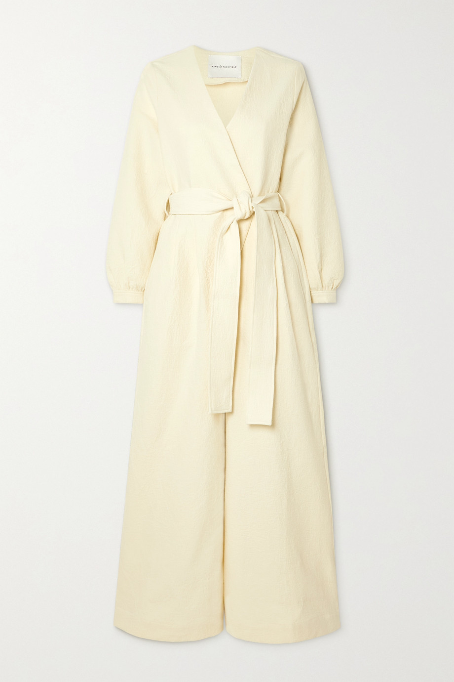 King & Tuckfield Wrap-effect belted cotton-cloqué jumpsuit