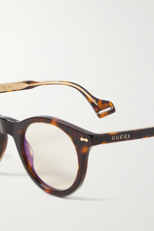 Gucci Lunettes de vue rondes en acétate effet écaille à verres anti-lumière bleue