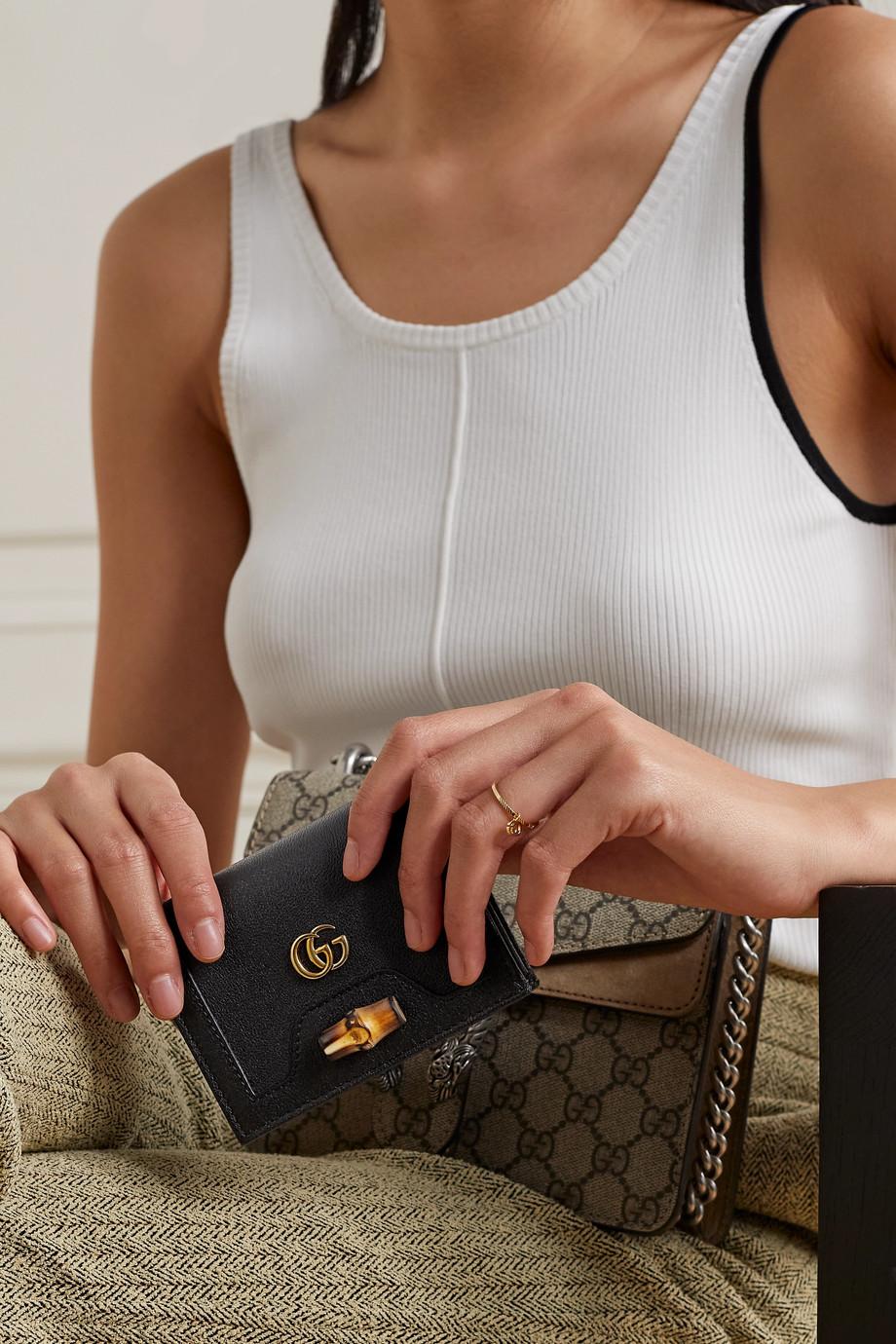 Gucci Portefeuille en cuir texturé à ornements Diana