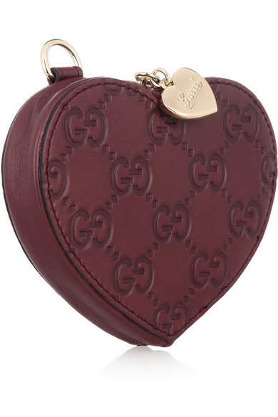 d4833434a08 Gucci. Monogrammed leather heart coin purse