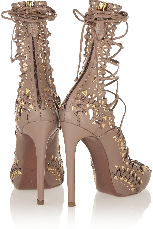 Alaïa Studded lace-up leather sandals