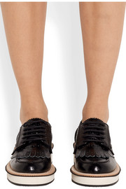 Fringed platform brogues in black leather