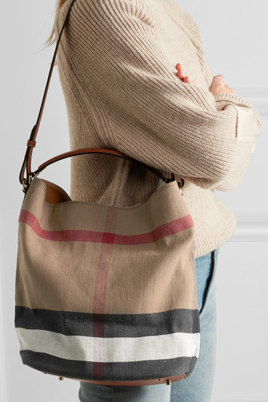 33220077bdec Burberry. Leather-trimmed checked canvas hobo bag.  556.50. Zoom In
